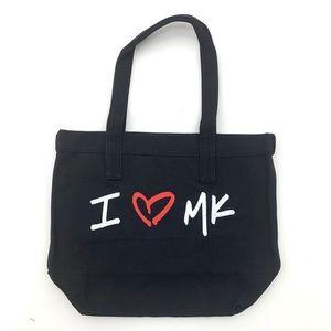 I love Micheal Kors black tote by Macy's NEW